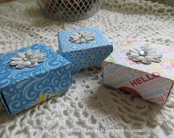 """Tiny gift boxes, set of 3, 2-1/8"""" x 2-1/8"""", origami, blue, white, orange, pink, polka dots, silver flower on top."""