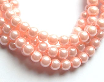 100 6mm pink glass pearls