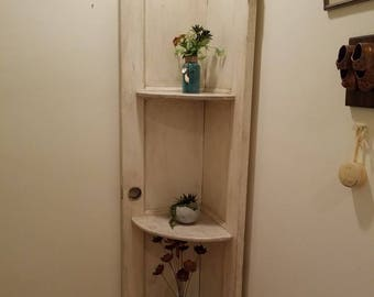 Corner shelf with three shelves