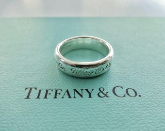 Authentic Tiffany & Co. Notes Sterling Silver Script Band Ring Size 7.5