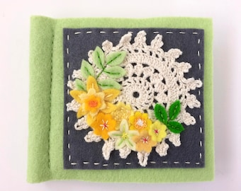 yellow and green wool felt needle book with cute crocheted doily and lots of felt flowers and leaves and hand embroidery