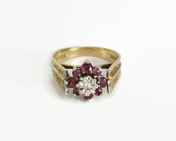 Diamond and natural ruby flower ring in 9 carat yellow and white gold setting, fancy ribbed wings, London, size M.5 / 6.5, 1978