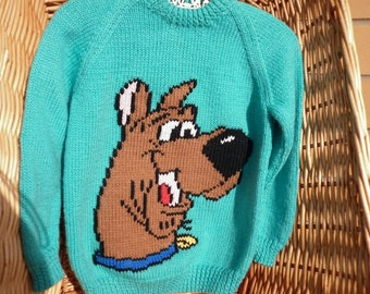 "This sweater fits a 24 inch chest or a 3-4 year old and has ""Scooby Doo"" embroidered on the front"