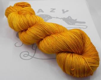 Amber Waves: 438 yards 50/50 Merino/Silk fingering weight yarn in Radiance yarn base.