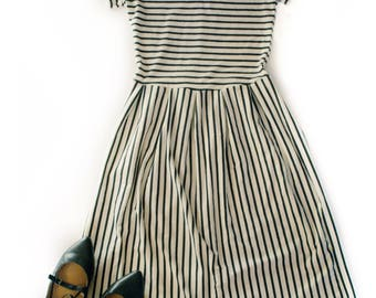 Womens Knee Length Pleated Dress, black and off white stripes