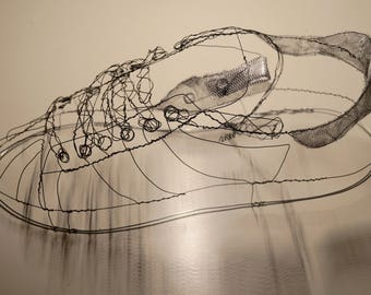 A wire sculpture of a trainer