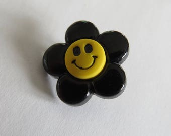 Yellow and black flower shaped button