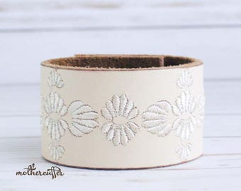 CUSTOM HANDSTAMPED off white leather cuff with stitching by mothercuffer