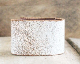 CUSTOM HANDSTAMPED distressed white leather cuff by mothercuffer