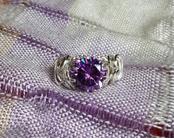 FEBRUARY BIRTHSTONE,  Natural Amethyst, 10mm round cut stone wrapped in sterling silver solitaire mount.  Size 7
