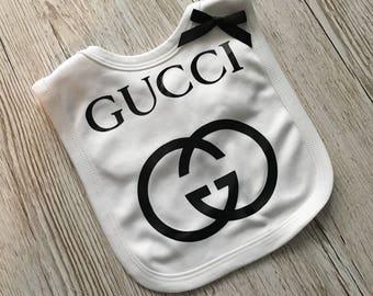 Designer inspired white  pop over baby bib with black satin bow