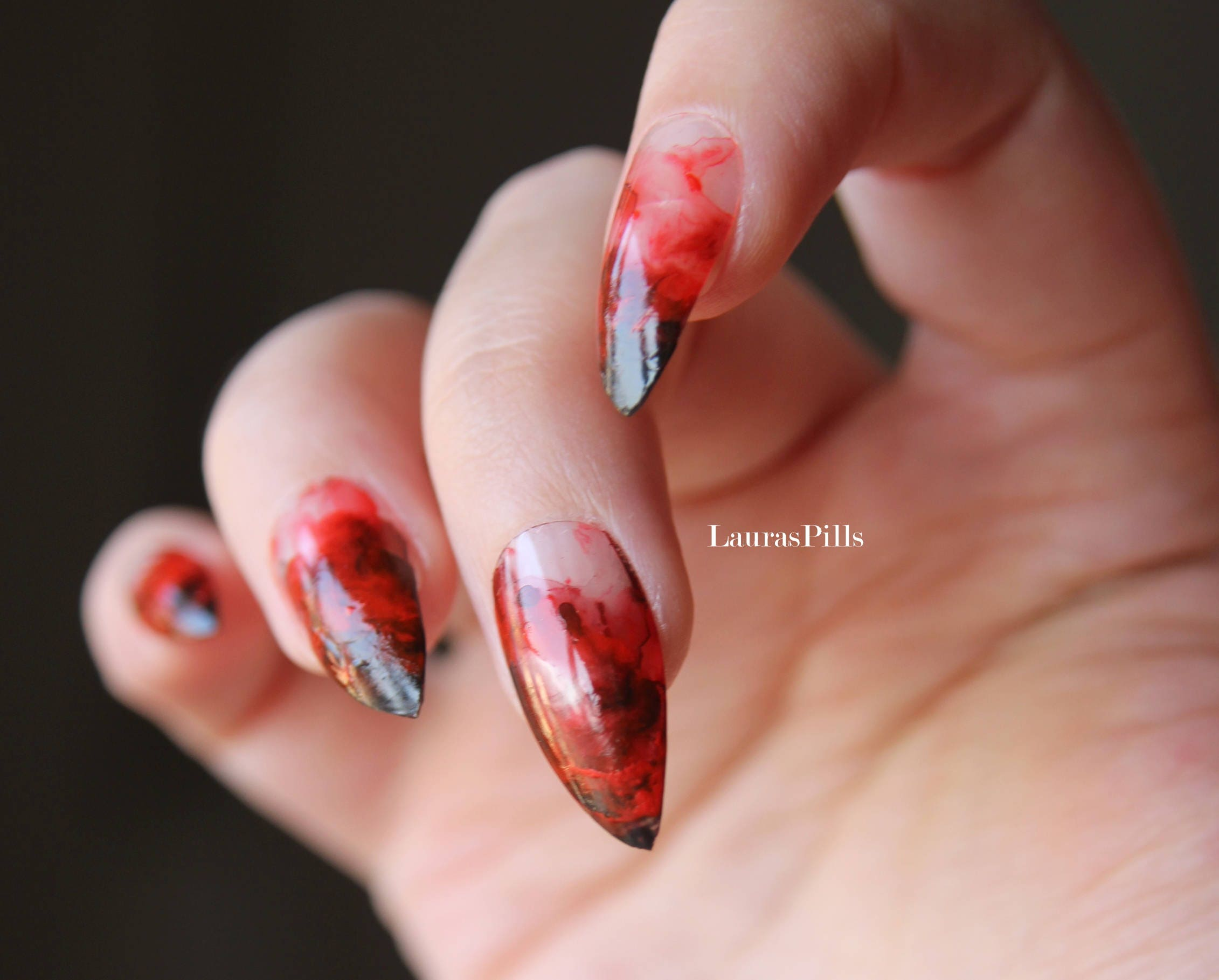 Red and black ink marble stiletto false nails Halloween false