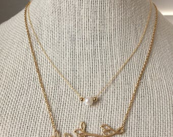 Branch Necklace and Pearl necklace.