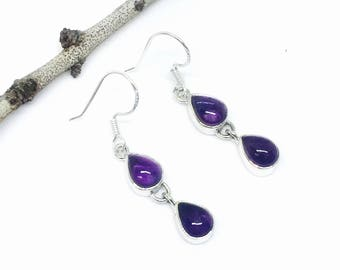Amethyst Earrings set in Sterling silver 92.5. Genuine natural amethyst stones. Perfectly matched stones. Length - 1 inch.