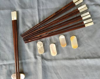 Handmade Vietnamese Rosewood Chopsticks with Mother of Pearl accents with matching rests. Set of 5