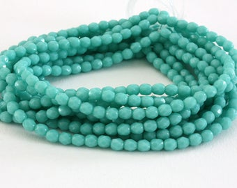 25 4 mm turquoise Czech glass faceted beads