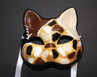 Unique Cat mask with brown, black, tan, white, and gold design