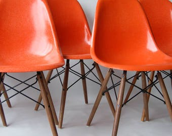 Three Sets Available   Four Matched Vintage Eames DSW Red Orange Fiberglass  Sideshells On Walnut Dowel