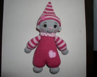 bright pink amigurumi kind cuddly doll