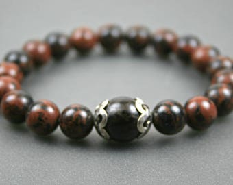 Mahogany obsidian stacking stretch bracelet with buri root accent flanked by sterling silver open swirl bead caps