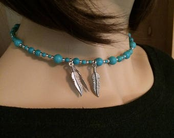 Turquoise necklace: wooden beads and feathers