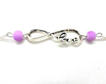 Silver infinity bracelet love writing, purple bead