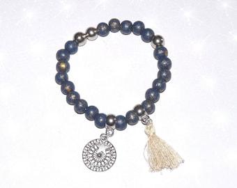 Black/silver beads, filigree rose bracelet, Star and beige tassel