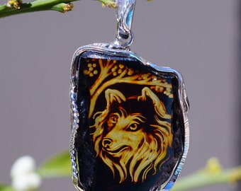 Carved Cognac Baltic Amber Wolf set in Solid 925 Sterling Silver Pendant
