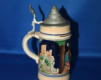 Vintage Simon Peter Gerz Hand Painted Stoneware Beer Stein with Raised 3 Part Scene and Pewter Lid Stamped Foreign Fabrikmarke 1930's