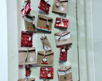 Advent calendar made by hand with natural materials to complete with treats and small gifts. Christmas Waiting for children