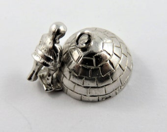 Inuit Tending to Their Igloo Sterling Silver Charm or Pendant.