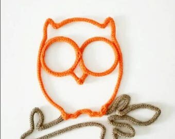 OWL on a branch achieved by knitting