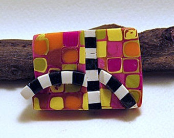 Brooch. Rectangular brooch in bright colours with black and white bands. Tokyo Subway range of brooches.