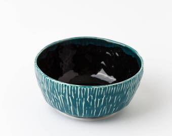 Hand-made bowl of blue-green