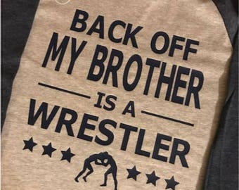 YOUTH Back Off My Brother is a Wrestler/Unisex Raglan Baseball T-Shirt/Multiple Colors/