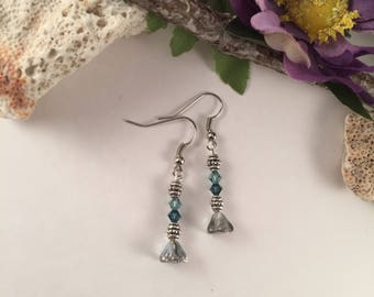 Silver flower earrings with teal Swarovski crystals