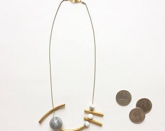 Calder necklace with brass tubes, marble stones and 14k gold plated chain