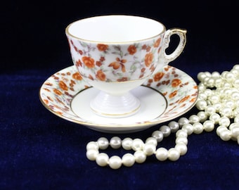Orange Footed Tea Cup and Saucer  Vintage  Floral print   Gold Trim  Numbered C 8814 Great Bridal or Baby Shower Favor