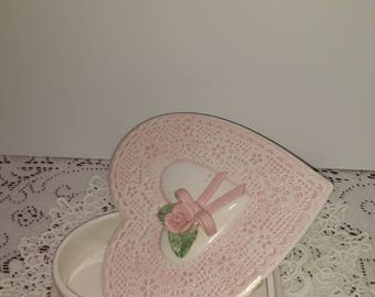 Heart shape covered dish with lace like finish and pink ribbon bow
