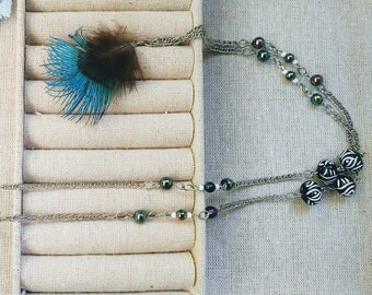 Long necklace with feather paon50% was 20.99