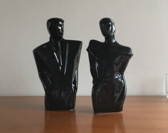 Years 80 modernist figures of man and woman in glossy black ceramics.