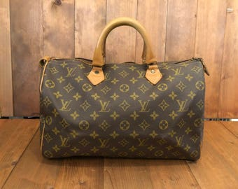 Rare Vintage LOUIS VUITTON Monogram Speedy 35 Handbag by the French Company Louis Vuitton in USA in 70's