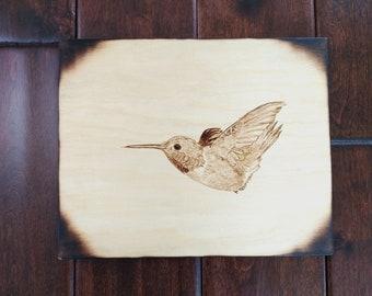 Woodburning of hummingbird in flight