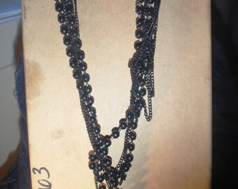 long beaded multi strand black necklace