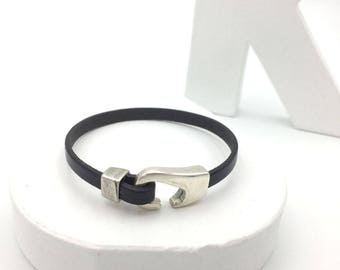 Man and black leather bracelet and silver hook