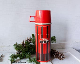 Vintage Red and Black Thermos Brand - Drink or Soup Cannister - with Red Cup - In working condition.