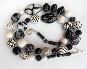 A statement black and white Kazuri ceramic, hand made bead, necklace.
