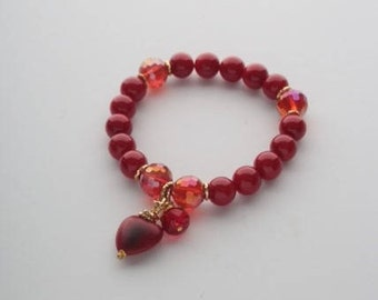 Bracelet with red jade and glass crystal. Natural stones 10mm