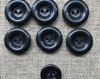 Vintage Set of 7 Round Plastic Black Buttons, Two Hole, Two Sizes