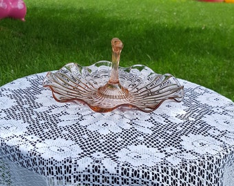Beautiful pink scalloped and ruffled one handle serving dish